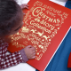 Child Holding Personalized Christmas Storybook Collection