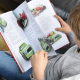 Child Holding Personalized Disney's Cars Ultimate Collection Book