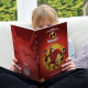 Child holding Personalized Incredibles 2 book